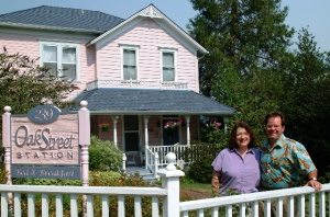 Hosts Sue and John in front of the Oak Street Station B&B